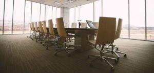 empty conference room with chairs around a table