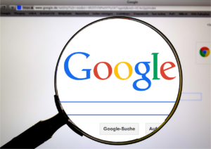 magnifying glass looking at the Google Browser