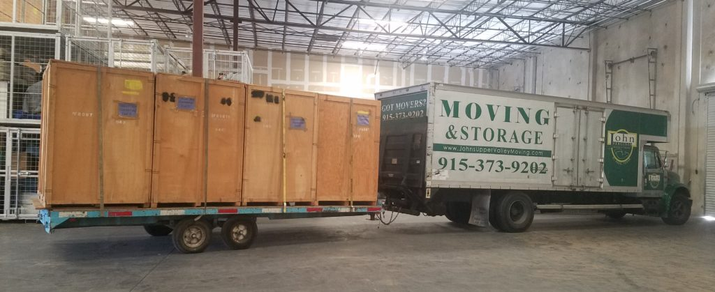 moving truck inside warehouse