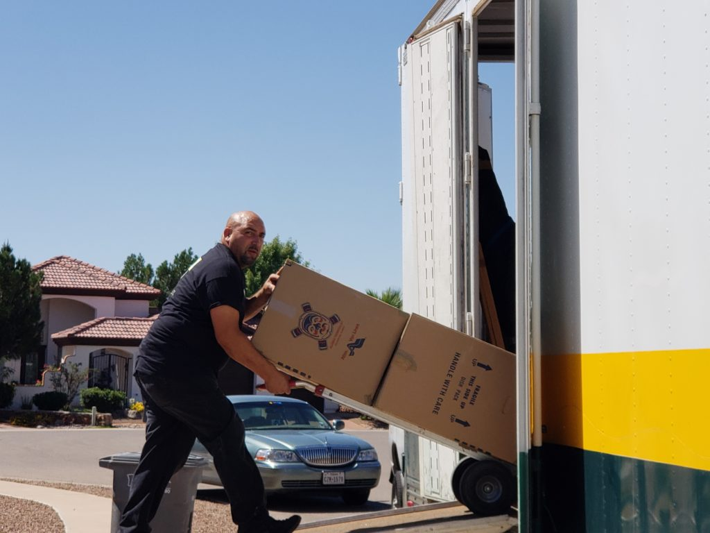 moving boxes into truck
