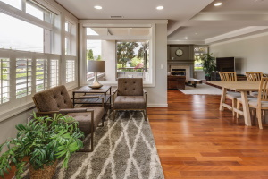 clean home with wood floors, rug and chairs